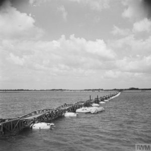 Construction in Britain: A section of the floating causeway parked awaiting D Day. Copyright: © IWM.