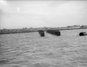 Floating breakwaters (Bombardons) moored in Weymouth Bay during experiments.