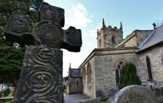 View of Eyam, St. Lawrence's Church: c8th to c9th Anglo Saxon cross (detail)
